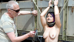 Butch girl in outdoor bondage