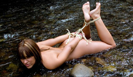 Nude outdoor bondage